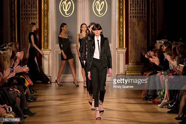 Models walk the runway during the Valentin Yudashkin Ready-To-Wear Fall/Winter 2013 show as part of Paris Fashion Week at Hotel Westin on March 5,...