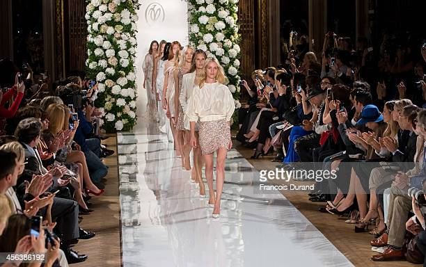 Models walk the runway during the Valentin Yudashkin show as part of the Paris Fashion Week Womenswear Spring/Summer 2015 on September 30, 2014 in...