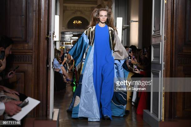 Models walk the runway during the Valentino Haute Couture Fall Winter 2018/2019 show as part of Paris Fashion Week on July 4 2018 in Paris France
