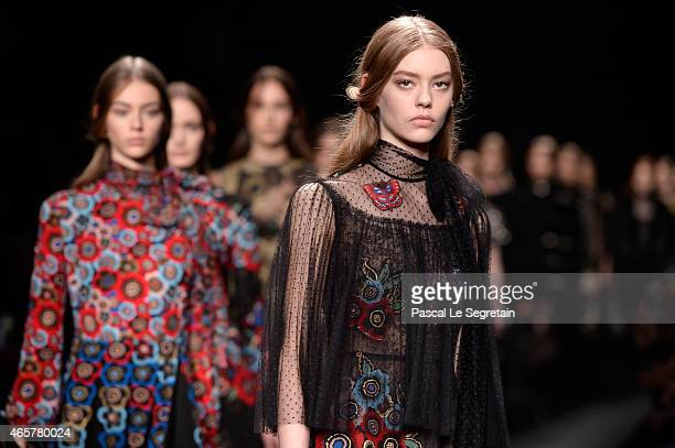 Models walk the runway during the Valentino show as part of the Paris Fashion Week Womenswear Fall/Winter 2015/2016 on March 10 2015 in Paris France