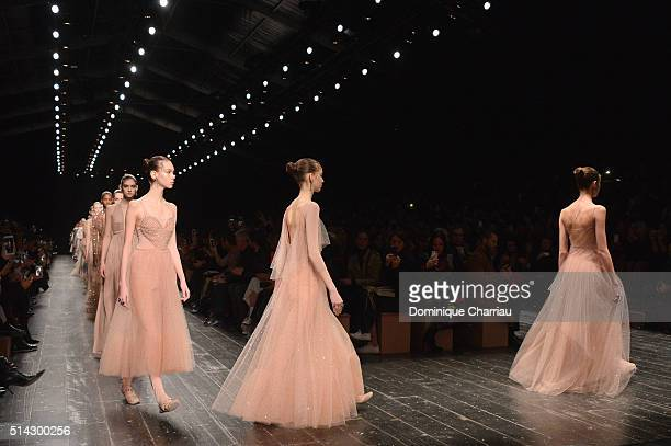 Models walk the runway during the Valentino show as part of the Paris Fashion Week Womenswear Fall/Winter 2016/2017 on March 8 2016 in Paris France