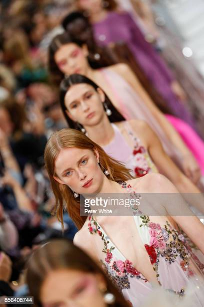 Models walk the runway during the Valentino show as part of the Paris Fashion Week Womenswear Spring/Summer 2018 on October 1 2017 in Paris France