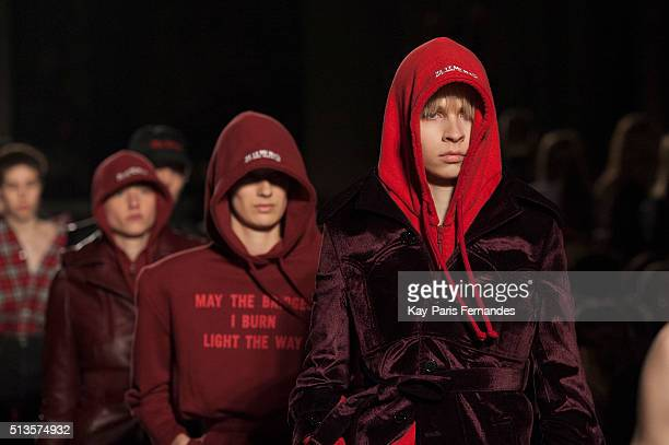 Models walk the runway during the Vetements show as part of the Paris Fashion Week Womenswear Fall/Winter 2016/2017 on March 3 2016 in Paris France