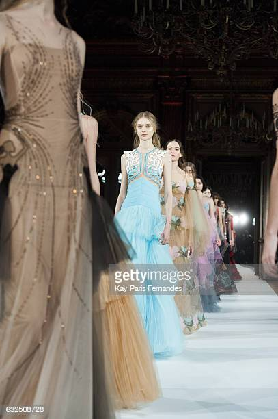 Models walk the runway during the Yanina Couture Spring Summer 2017 show as part of Paris Fashion Week on January 23 2017 in Paris France