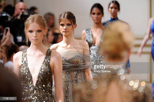 Models walk the runway during the Zuhair Murad show as part of Paris Fashion Week HauteCouture Fall/Winter 20132014 at Hotel de Montmorency on July 4...