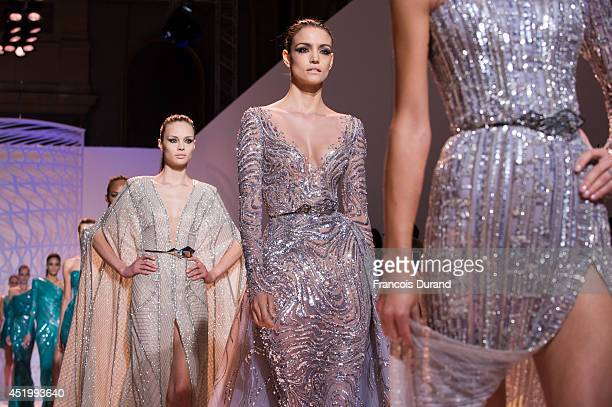 Models walk the runway during the Zuhair Murad show as part of Paris Fashion Week Haute Couture Fall/Winter 20142015 at Palais Des Beaux Arts on July...
