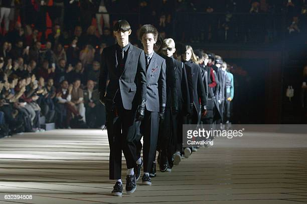 Models walk the runway finale at the Dior Homme Autumn Winter 2017 fashion show during Paris Menswear Fashion Week on January 21 2017 in Paris France