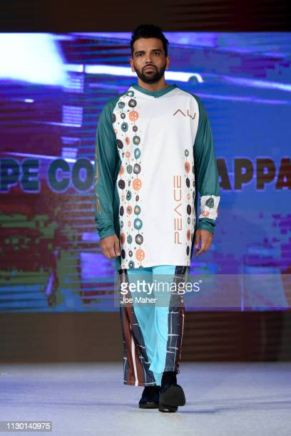 Models walk the runway for American Umma at the House of iKons show during London Fashion Week February 2019 at the Millennium Gloucester London...