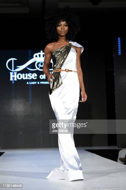 Models walk the runway for Ana De Sa at the House of iKons show during London Fashion Week February 2019 at the Millennium Gloucester London Hotel on...