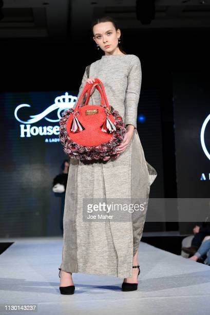 Models walk the runway for Aranjuez at the House of iKons show during London Fashion Week February 2019 at the Millennium Gloucester London Hotel on...