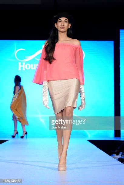 Models walk the runway for ARenee Fashion at the House of iKons show during London Fashion Week February 2019 at the Millennium Gloucester London...