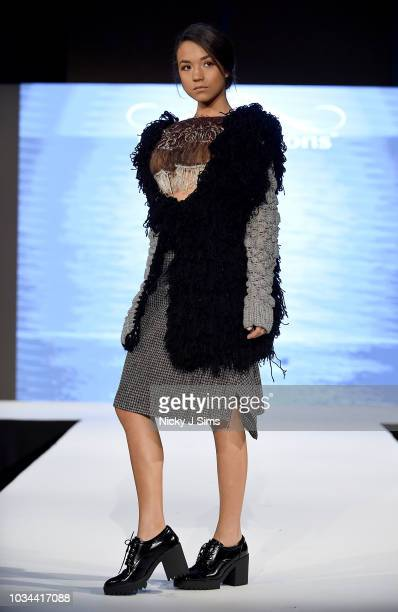 Models walk the runway for Be Unique Be You on day 2 of the House of iKons show during London Fashion Week September 2018 at the Millennium...