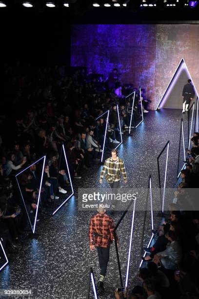 Models walk the runway for Brand Who during Mercedes Benz Fashion Week Istanbul at Zorlu Performance Hall on March 28 2018 in Istanbul Turkey