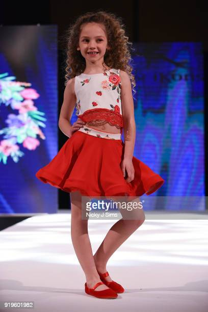 Models walk the runway for Camellia Couture at the House of iKons show during London Fashion Week February 2018 at Millenium Gloucester London Hotel...