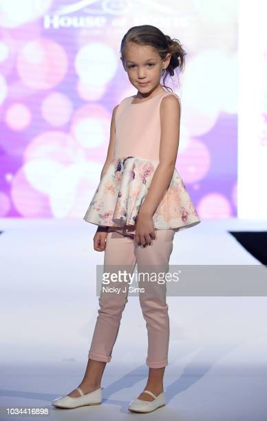 Models walk the runway for Camellia Couture on day 2 of the House of iKons show during London Fashion Week September 2018 at the Millennium...
