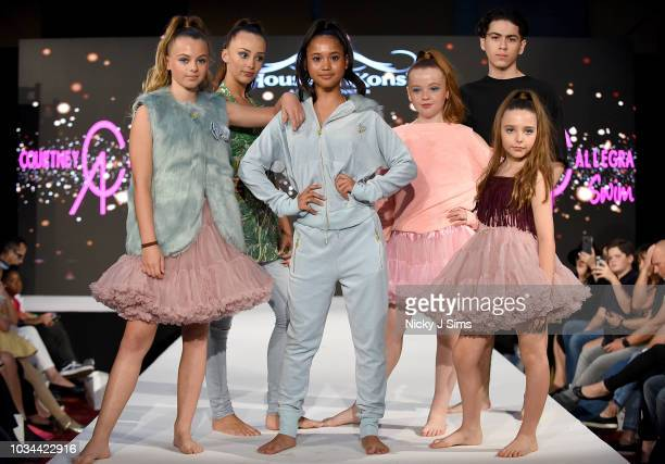 Models walk the runway for Courtney Allegra on day 2 of the House of iKons show during London Fashion Week September 2018 at the Millennium...