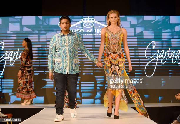 Models walk the runway for Czarina Kaftans on day 1 of the House of iKons show during London Fashion Week September 2018 at the Millennium Gloucester...