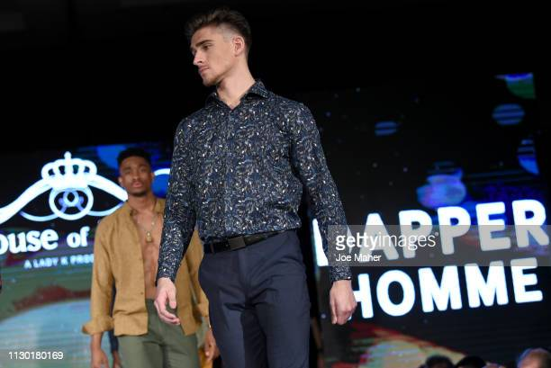 Models walk the runway for Dapper Homme at the House of iKons show during London Fashion Week February 2019 at the Millennium Gloucester London Hotel...