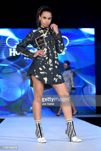 Models walk the runway for Dead Money by Mimi H at the House of iKons show during London Fashion Week February 2019 at the Millennium Gloucester...