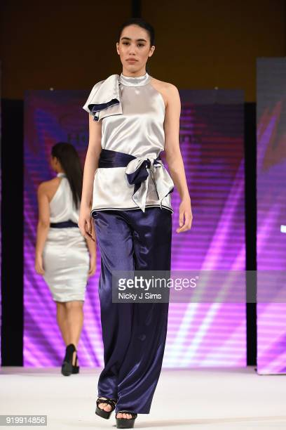 Models walk the runway for Designed by Josh at the House of iKons show during London Fashion Week February 2018 at Millenium Gloucester London Hotel...