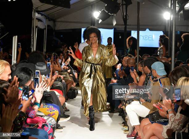 Models walk the runway for Fe Noel fashion show a part of Harlem's Fashion Row during New York Fashion Week at La Marina Restaurant Bar Beach Lounge...