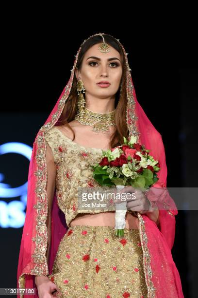 Models walk the runway for Fitoor at the House of iKons show during London Fashion Week February 2019 at the Millennium Gloucester London Hotel on...