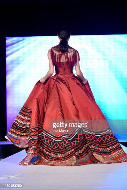 Models walk the runway for Hilltribe House Fashion at the House of iKons show during London Fashion Week February 2019 at the Millennium Gloucester...