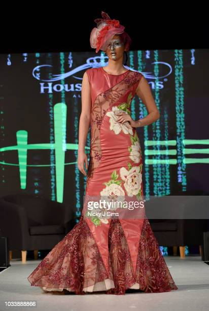 Models walk the runway for Honee on day 1 of the House of iKons show during London Fashion Week September 2018 at the Millennium Gloucester London...