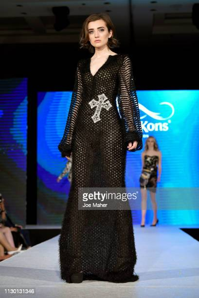 Models walk the runway for Jacinta Ligon at the House of iKons show during London Fashion Week February 2019 at the Millennium Gloucester London...