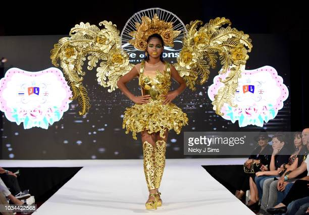 Models walk the runway for JAL Fashion on day 2 of the House of iKons show during London Fashion Week September 2018 at the Millennium Gloucester...