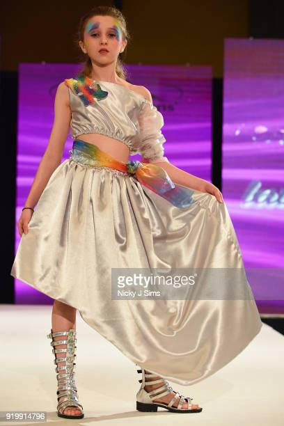 Models walk the runway for Lavender Rose Designs at the House of iKons show during London Fashion Week February 2018 at Millenium Gloucester London...