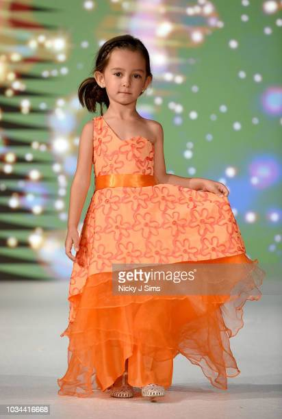 Models walk the runway for Little Royals on day 2 of the House of iKons show during London Fashion Week September 2018 at the Millennium Gloucester...