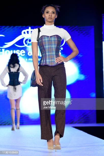Models walk the runway for Loch Dress at the House of iKons show during London Fashion Week February 2019 at the Millennium Gloucester London Hotel...