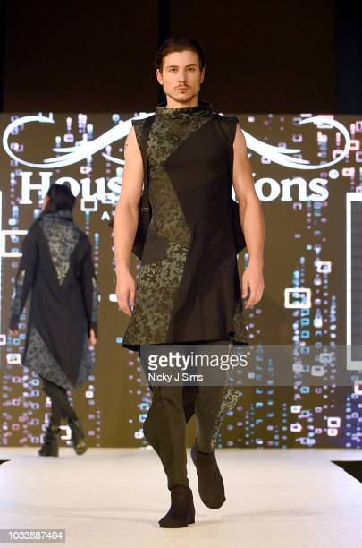 Models walk the runway for MEM on day 1 of the House of iKons show during London Fashion Week September 2018 at the Millennium Gloucester London...