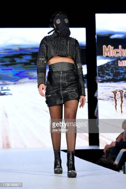 Models walk the runway for Michael Lombard at the House of iKons show during London Fashion Week February 2019 at the Millennium Gloucester London...