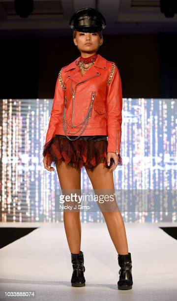 Models walk the runway for Michael Lombard on day 1 of the House of iKons show during London Fashion Week September 2018 at the Millennium Gloucester...