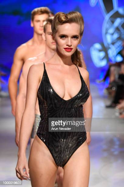 A model walks the runway for Mister Triple X at Miami Swim Week powered by Art Hearts Fashion Swim/Resort 2018/19 at Faena Forum on July 15 2018 in...