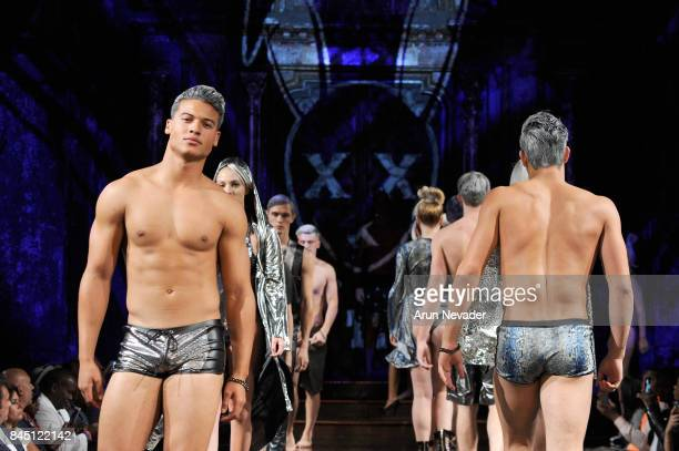 Model JanLuis Castellanos and models walk the runway for Mister Triple X Metallix Collection at New York Fashion Week NYFW Art Hearts Fashion at The...
