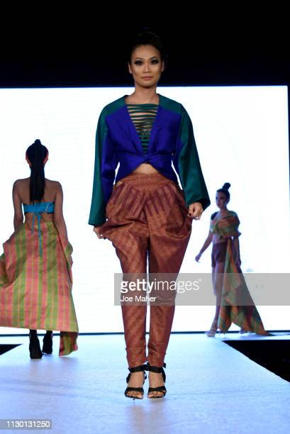 Models walk the runway for Mullika Nakara at the House of iKons show during London Fashion Week February 2019 at the Millennium Gloucester London...
