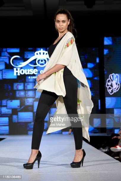 Models walk the runway for Nadia Azumi at the House of iKons show during London Fashion Week February 2019 at the Millennium Gloucester London Hotel...