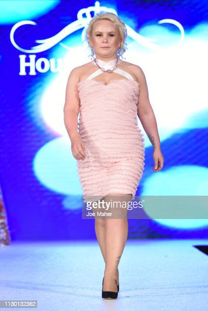 Models walk the runway for Nanalola Couture by Monica Jones at the House of iKons show during London Fashion Week February 2019 at the Millennium...