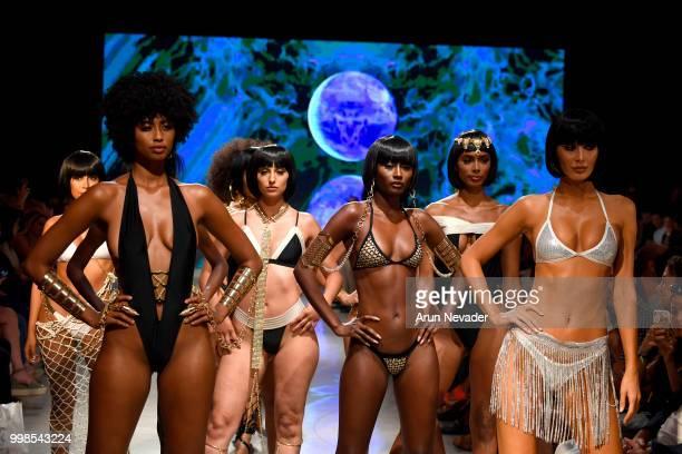 Models walk the runway for OMG Miami Swimwear at Miami Swim Week powered by Art Hearts Fashion Swim/Resort 2018/19 at Faena Forum on July 13, 2018 in...