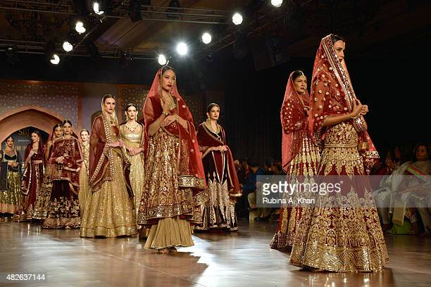 Models walk the runway for Reynu Taandon's Persian inspired couture line on day four of the Fashion Design Council of India's Amazon India Couture...