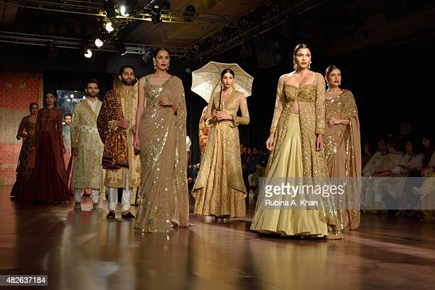 Models walk the runway for Rimple and Harpreet Narula's couture line inspired by the erstwhile days of the Indian Maharajahs at the Fashion Design...