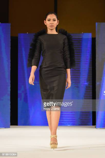 Models walk the runway for Shahenda Hegazy at the House of iKons show during London Fashion Week February 2018 at Millenium Gloucester London Hotel...