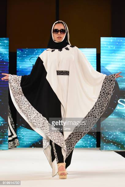 Models walk the runway for Shenannz at the House of iKons show during London Fashion Week February 2018 at Millenium Gloucester London Hotel on...