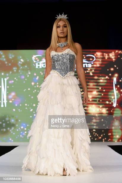 Models walk the runway for Sigrun on day 1 of the House of iKons show during London Fashion Week September 2018 at the Millennium Gloucester London...