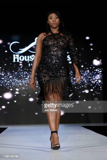 Models walk the runway for Taj B Designs at the House of iKons show during London Fashion Week February 2019 at the Millennium Gloucester London...