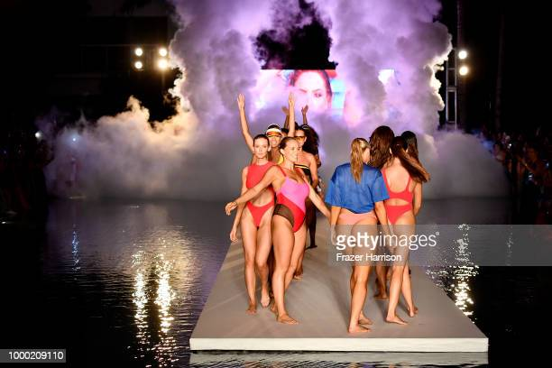 Models walk the runway for the 2018 Sports Illustrated Swimsuit show at PARAISO during Miami Swim Week at The W Hotel South Beach on July 15 2018 in...