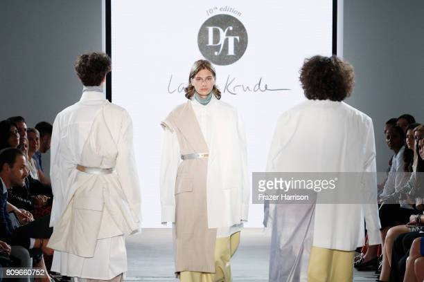 Models walk the runway for the designer Lara Krude at the fashion talent award 'Designer for Tomorrow' by Peek Cloppenburg and Fashion ID hosted by...
